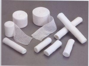 Side-woven bandages